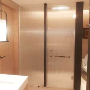 fluted-glass-shower-door